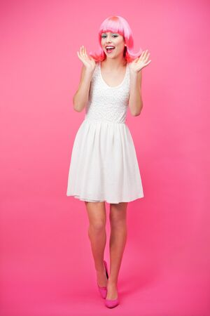 flirtatious: Beautiful young woman over pink background Stock Photo