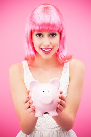 Attractive woman holding piggy bank photo