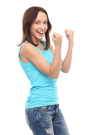 clenching fists: Happy young woman clenching fists