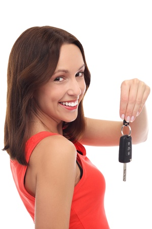 Smiling woman showing car key Stock Photo - 17052668
