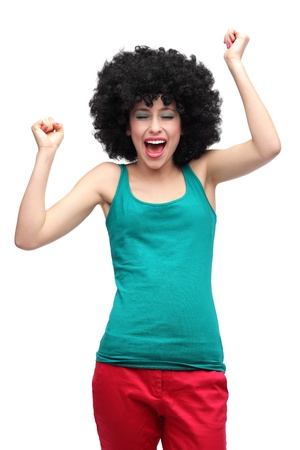 clenching fists: Happy woman wearing afro wig
