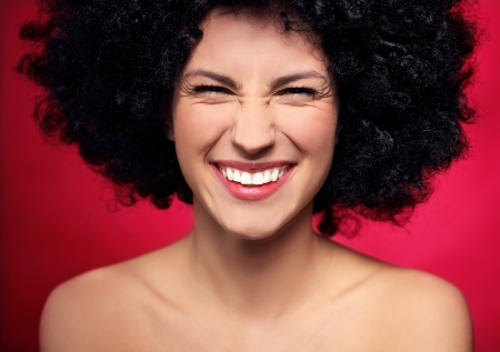 hairpiece: Woman with black afro hairstyle smiling