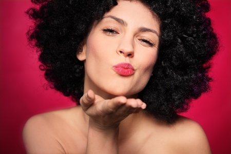 hairpiece: Woman with afro blowing a kiss