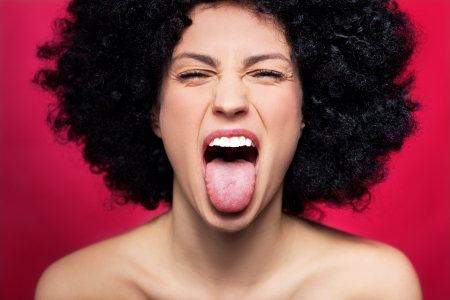 Woman sticking her tongue out photo