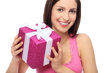 Smiling woman holding gift photo