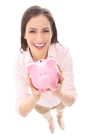 high angle shot: Woman holding piggy bank Stock Photo