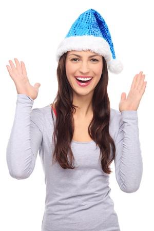 Woman in Santa hat gesturing Stock Photo
