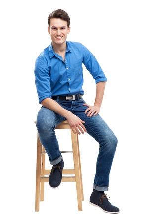 bar chair: Casual man sitting Stock Photo