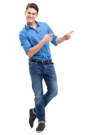 dedo se�alando: Hombre joven que se�ala Foto de archivo