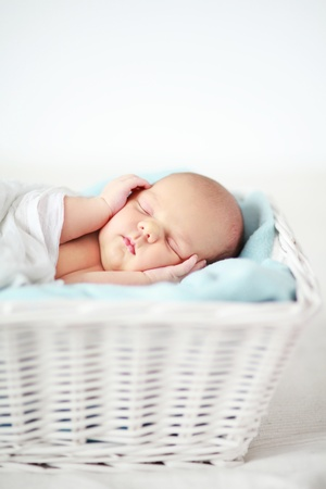 small basket: Baby sleeping in a basket