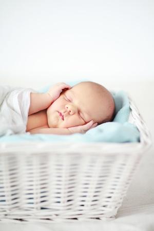 newborns: Baby sleeping in a basket