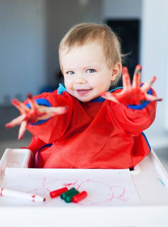 felt tip pen: Cute child with painted hands Stock Photo