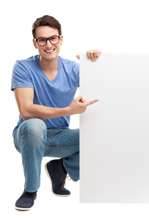 Young man with blank board photo