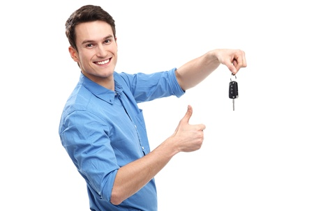 Homme avec des clés de voiture et les Thumbs Up Banque d'images