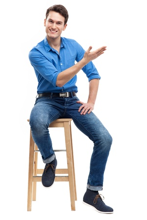 sitting on: Casual man sitting Stock Photo