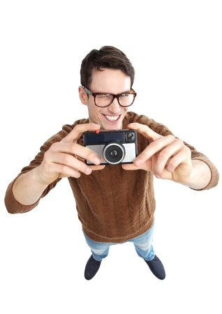 geeky: Geeky man with vintage camera