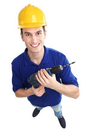 high angle shot: Man holding power drill Stock Photo