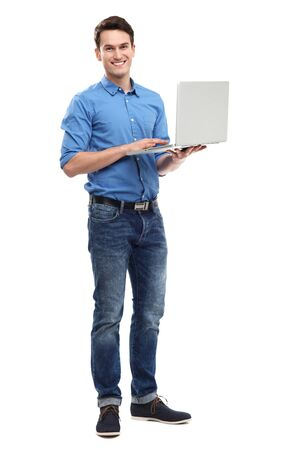 casual caucasian: Young man holding laptop Stock Photo