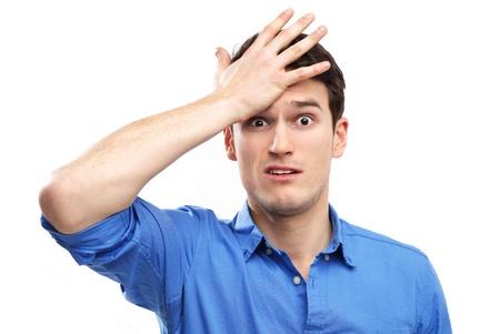 L'uomo si dà uno schiaffo sulla testa Archivio Fotografico