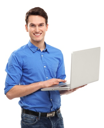 laptop stand: Portrait of young man holding laptop Stock Photo
