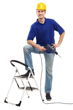 Builder with ladder and drill photo