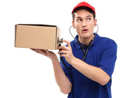 prognostic: Delivery man examining box with stethoscope Stock Photo