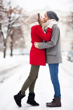 winter couple: Young couple kissing on winter day