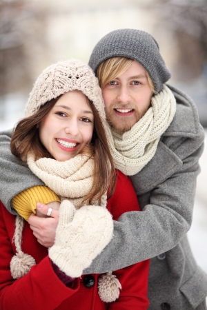Couple in Winter Clothing Embracing photo