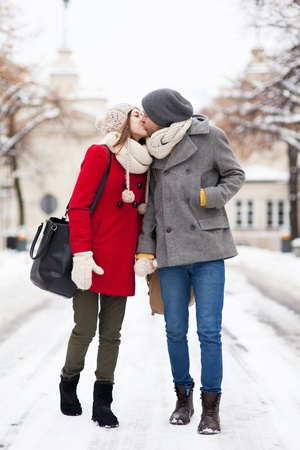 Young couple kissing on winter day photo
