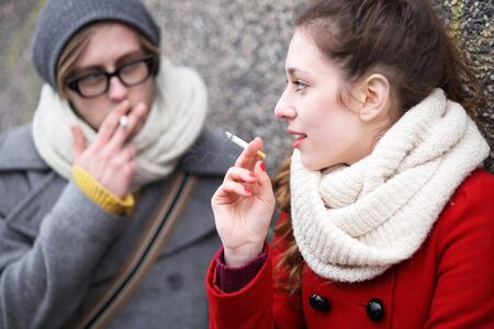 smoking: Young couple with cigarettes