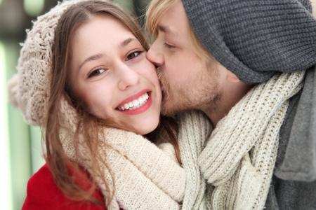 Young man kissing his girlfriend photo