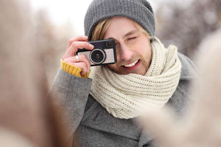 Young man with vintage camera photo