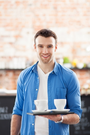Waiter with coffee on tray photo