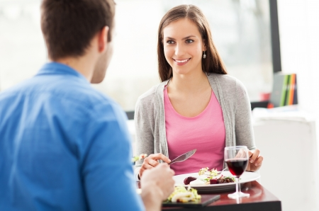 dining out: Couple having meal in restaurant