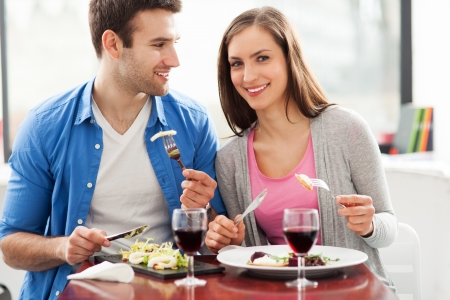 Couple dining in restaurant photo