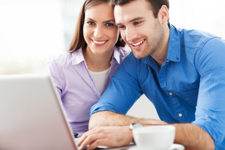 Young couple using laptop photo