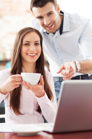 Young business people using laptop at cafe Stock Photo - 18617991