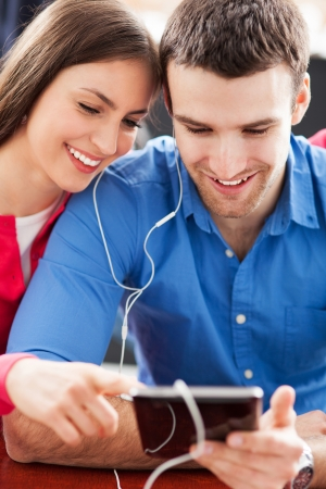 portable mp3 player: Couple with digital tablet