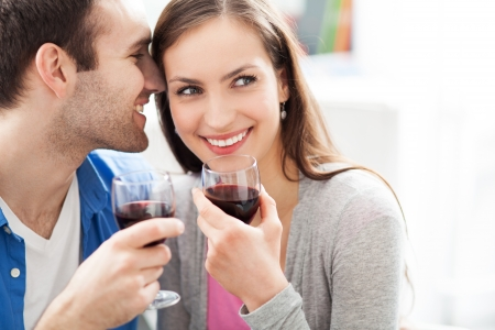 wine red: Young couple drinking wine Stock Photo