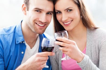 Couple toasting with red wine photo
