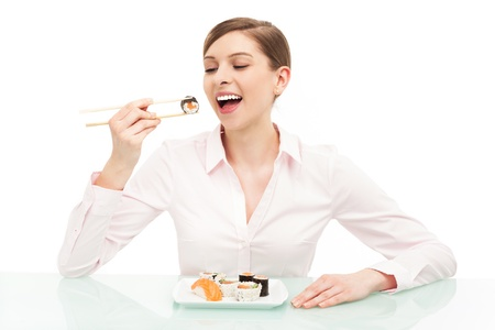 Beautiful woman eating sushi photo