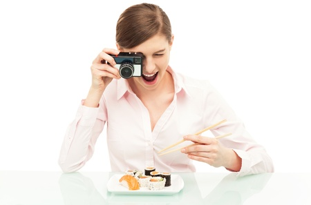 Woman photographing sushi photo