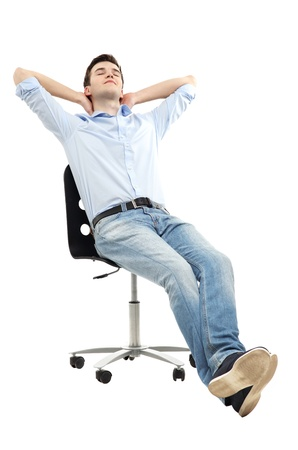people sitting on chair: Man relaxing in chair