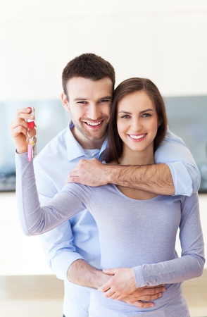 apartment house: New home owners with key