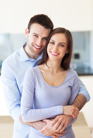 hugging couple: Young couple embracing Stock Photo