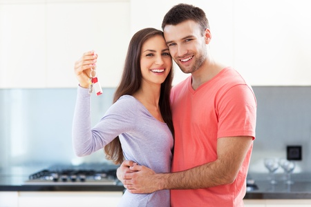home keys: Couple with keys to new home