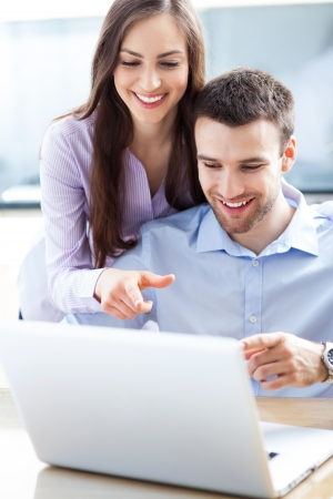 Business couple using laptop Stock Photo - 19328404