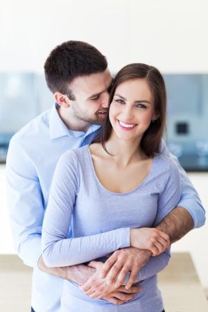 man woman hugging: Young couple hugging