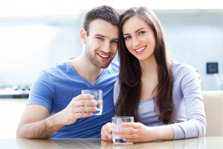 man drinking water: Couple with glasses of water Stock Photo