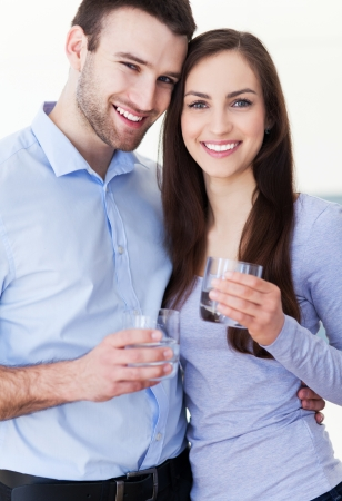 Couple with glasses of water Stock Photo - 19426894